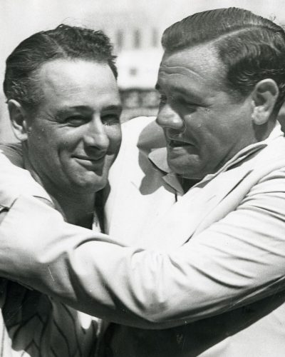 George Herman (Babe) Ruth (1895 - 1948) hugs former teammate Lou Gehrig (1903 - 1941), 1939. (Photo by Waite Hoyt Collection/Cincinnati Museum Center/Getty Images)