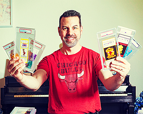 Image of a man holding up encased tickets